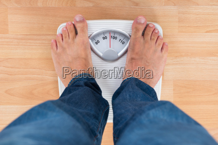 man standing on weighing scale