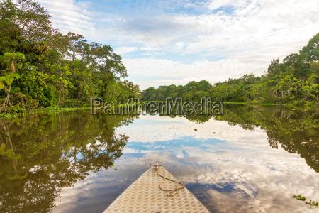 boat and amazon reflection