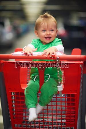 baby in shopping cart