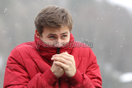 man shivering in cold winter