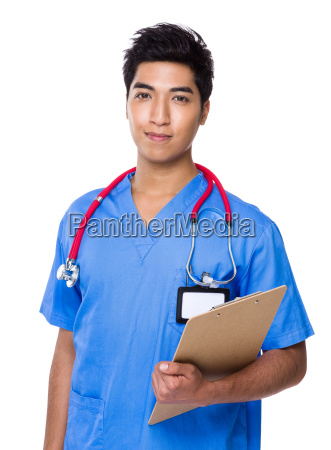 young doctor holding with clipboard