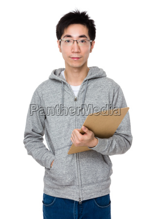asian businessman holding with clipboard