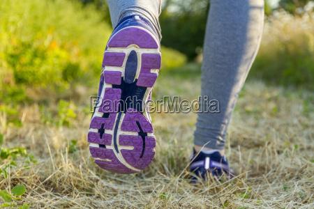 woman running in a field