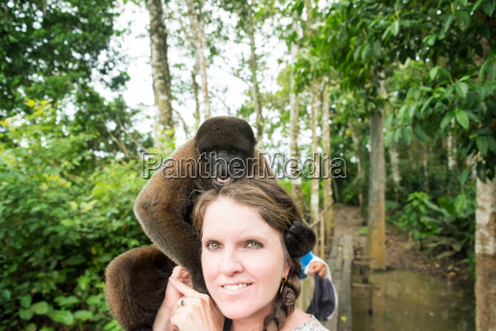 woolly monkey and woman