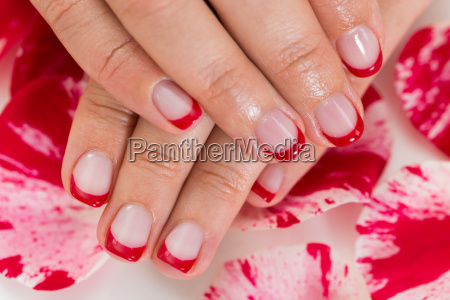 female hands with manicured nail varnish