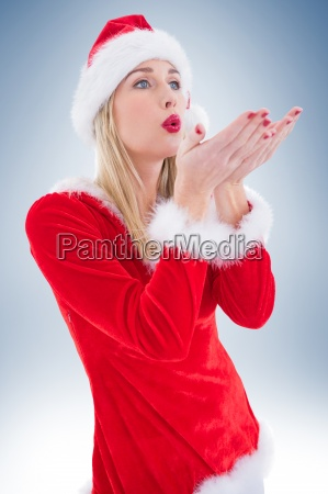 festive blonde blowing over hands