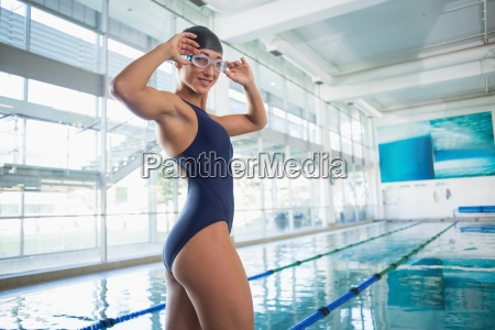 portrait of female swimmer by pool