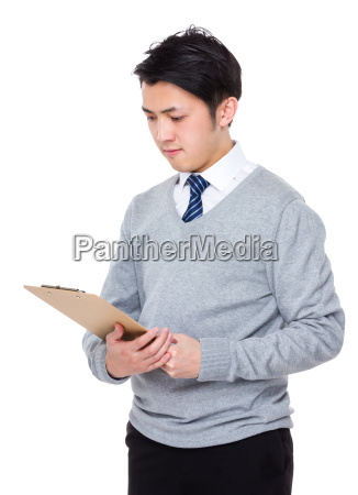 asian young businessman read on the
