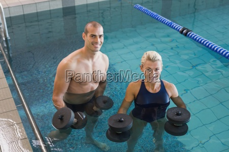 swimmers working out with foam dumbbells