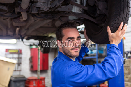 young attractive mechanic working on a