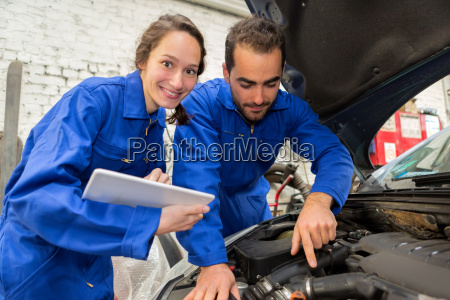 team of mechanics working at the