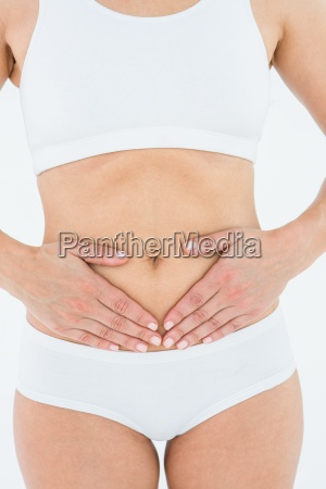 fit woman suffering stomach pain