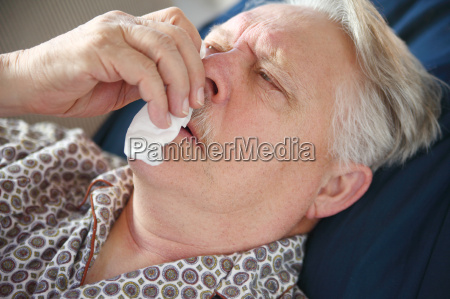 older man suffers from bad cold