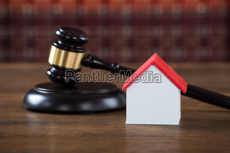 mallet with house model on table