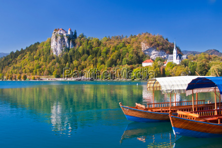 traditional wooden boats on lake bled