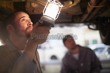 two car mechanics at work in