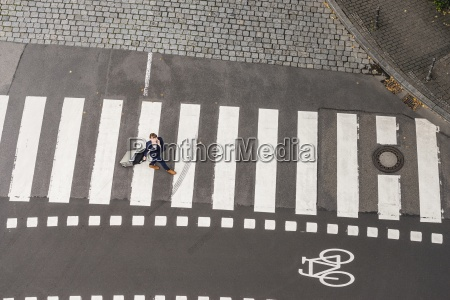 germany businesswoman with rolling suitcase walking