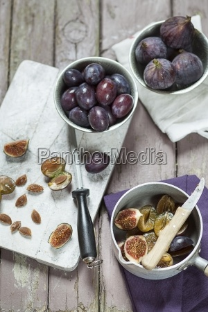 preparing plums and figs for making
