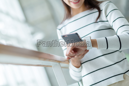 woman using wearable watch connecting to