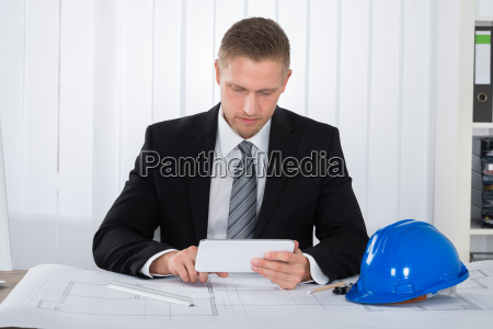 young male architecture using digital tablet