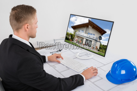 architect working on his computer in