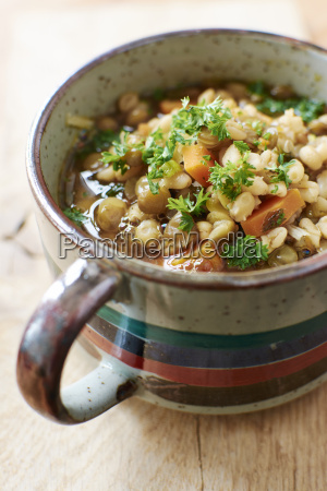 cup of lentil barley stew with