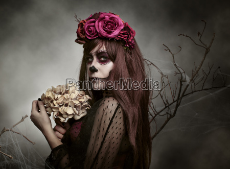 portrait of woman with sugar skull
