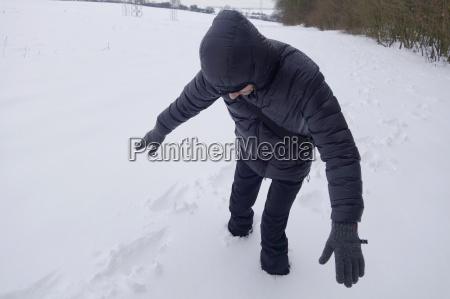 man stuck in deep snow