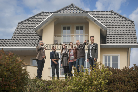 estate agent and family in front