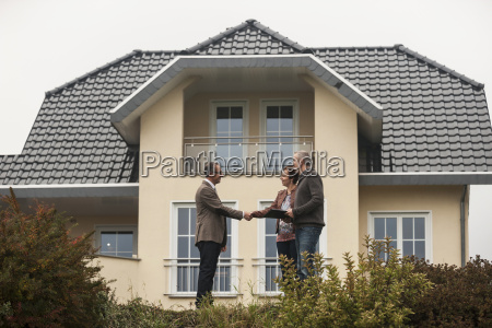 estate agent shaking hands with potential