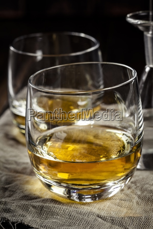tumblers with whisky