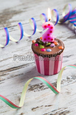 birthday muffin with chocolate buttons and