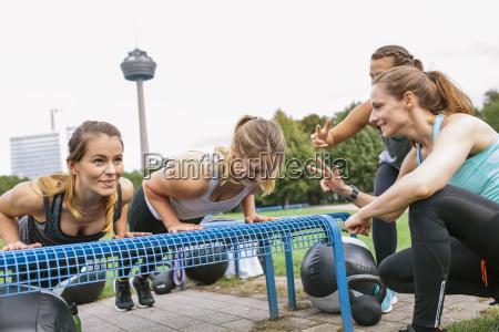 four women having an outdoor boot
