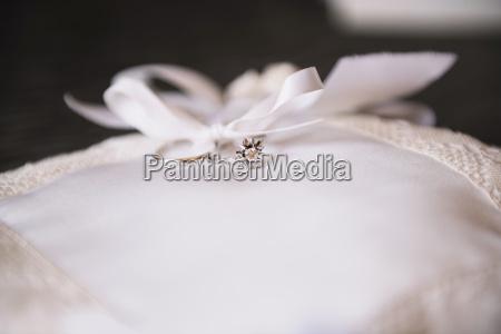 wedding rings on a white chushion