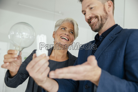 businesswoman and businessman comparing regular and