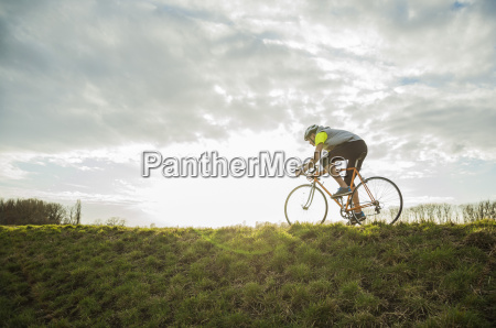 germany mannheim young man riding bicycle