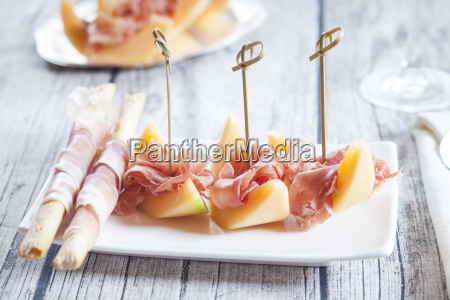 plate of charentais melon slices with