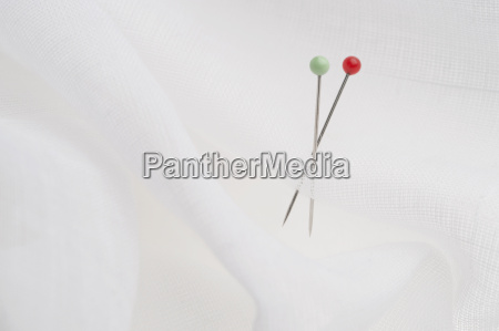 pins in white cloth couple