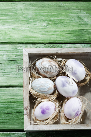 wooden box of pastel coloured easter