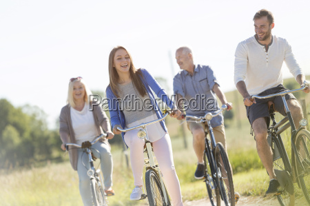 happy family bike riding in sunny