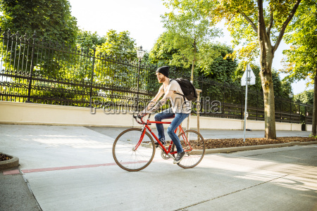 young man with racing cycle in