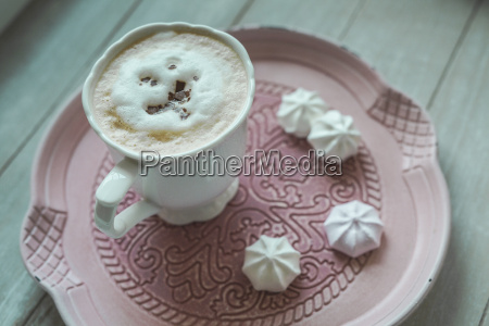 cup of white coffee with chocolate