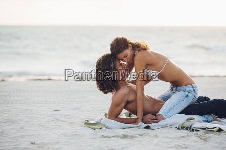 romantic young couple on beach