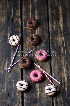 drinking straws and doughnuts with different