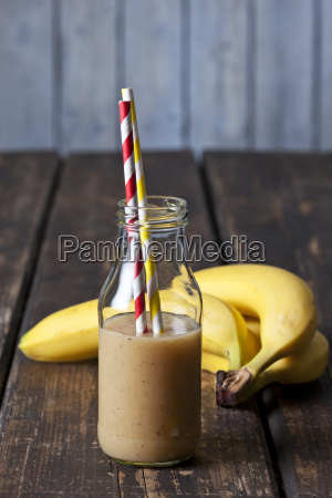 glass bottle of banana smoothie and