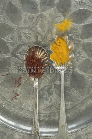 silver spoons of ground saffron and