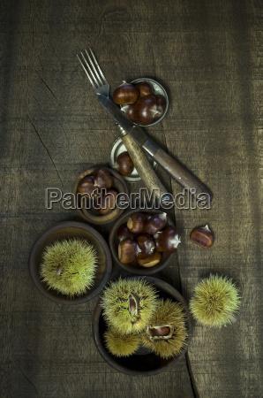 sweet chestnuts on dark wood