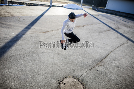 young man jumping with inlineskates