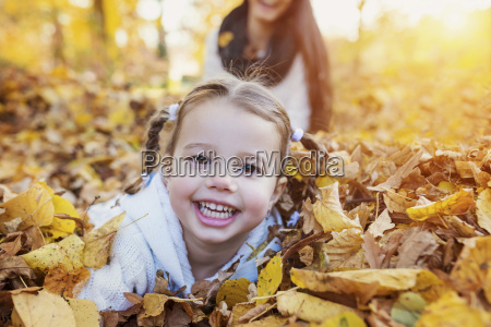 happy girl in autumn leaves