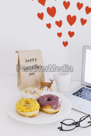 still life with laptop donuts valentines